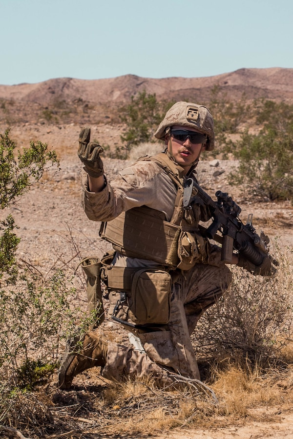 Cpl. Wyatt Witter, a scout team leader with Delta Company, 4th Light Armored Reconnaissance Battalion (LAR), 4th Marine Division, commands his Marines to push forward while conducting a platoon attack during Integrated Training Exercise (ITX) 4-21 at Marine Corps Air Ground Combat Center, Twentynine Palms, California on Aug. 2, 2021. ITX is the culmination of Marine Forces Reserve units' training cycle as they participate in a live-fire, combined arms exercise as a part of an integrated Marine Air Ground Task Force. (U.S Marine Corps photo by Lance Cpl. David Intriago)