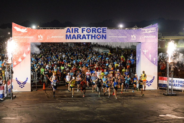Runners take off at the start of the 2019 Air Force Marathon 10k run at Wright-Patterson Air Force Base, Ohio, Sept. 21, 2019. More than 12,700 runners and 2,600 volunteers from all 50 states and 15 different countries came out to run in the races 23rd year. (U.S. Air Force photo by Wesley Farnsworth)