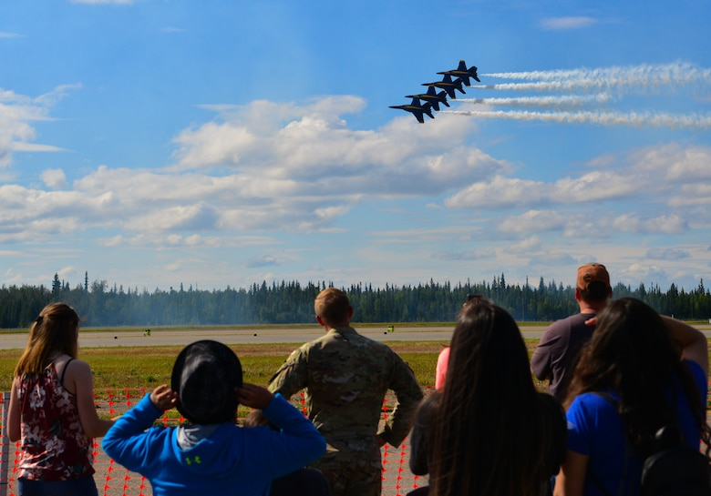 A crowd watches the U.S. Navy Air Demonstration Squadron, the Blue Angels, perform at the 2021 Arctic Lightning Airshow July 30th, 2021, on Eielson Air Force Base, Alaska.