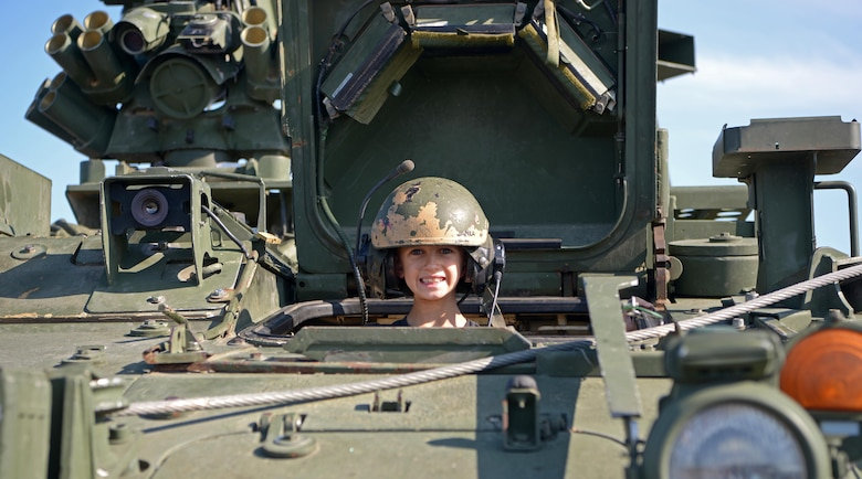 A child smiles for a photo in a U.S. Army vehicle static display during the Arctic Lightning Airshow July 31, 2021, one Eielson Air Force Base, Alaska.
