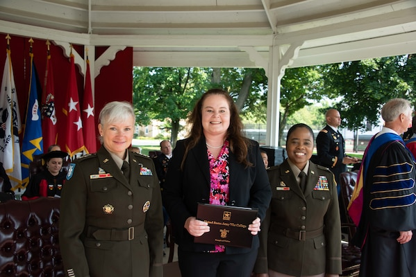 Amy Bednar (center), a research mathematician at the U.S. Army Engineer Research and Development Center's Information Technology Laboratory, graduated from the Army War College in Carlisle Barracks, Pennsylvania, July 23, 2021,. Bednar was part of a two-year distance education class, which included 391 students from military, federal agencies and other countries around the world.