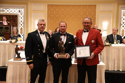Mr. Joe Rupp, a retired United States Marine Corps lieutenant colonel, and board member of the Young Lawyer Division of the Utah State Bar, receives the Bronze Minuteman award
