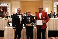 Brig. Gen. (Ret.) Larry Lunt, member of the Utah Air National Guard for 36 years, and former member of the Utah House of Representatives, receives the Bronze Minuteman award