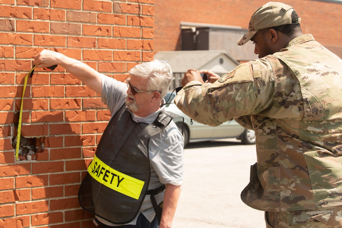 Don Jones, 375th Air Mobility Wing Safety occupational safety and health specialist, and U.S. Air Force Staff Sgt. Kenneth Reid, 375th Air Mobility Wing Safety occupational safety craftsman, documents structural damage on Scott Air Force Base, Illinois, August 12, 2021. Safety inspections are critical to prevent injuries to personnel and damage to military property and equipment. (U.S. Air Force photo by Airman 1st Class Stephanie Henry)