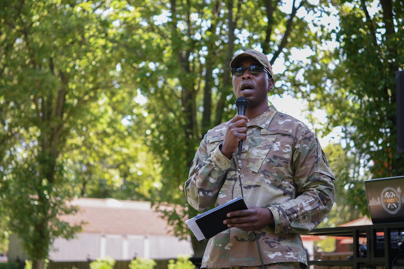 Chief Master Sgt. Ezekiel Ross, 316th Wing command chief, shares a brief message before the start of the Military Market and Enlisted Service Celebration, at the Community Commons on Joint Base Andrews, Md., Aug. 11, 2021.