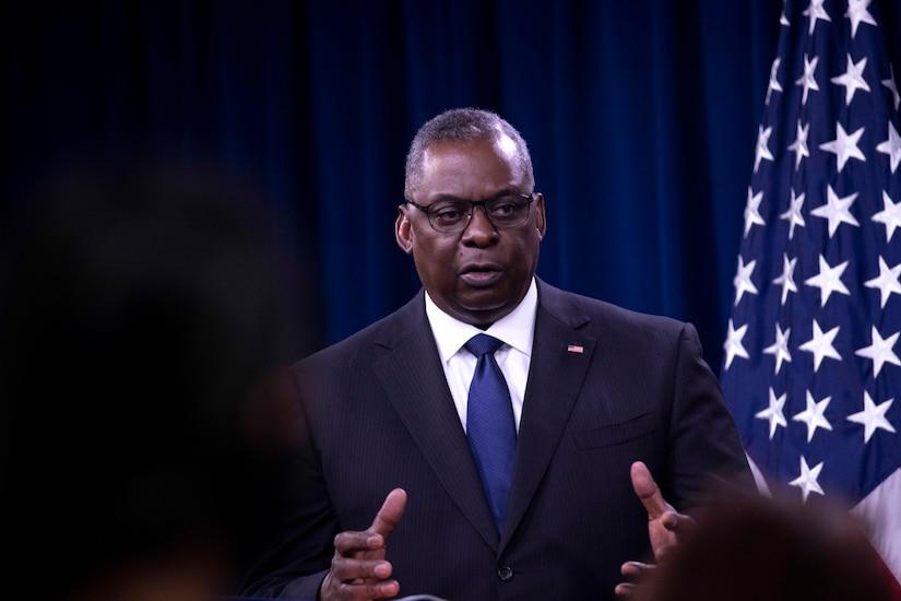 Secretary of Defense Lloyd J. Austin III speaks at a podium.