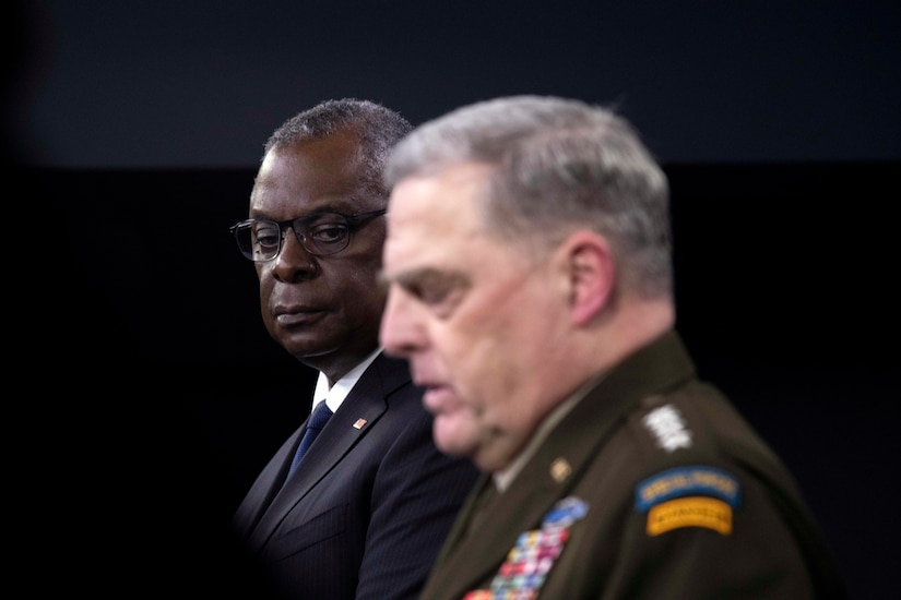 Secretary of Defense Lloyd J. Austin III and Joint Chiefs Chairman Army Gen. Mark A. Milley stand at podium.