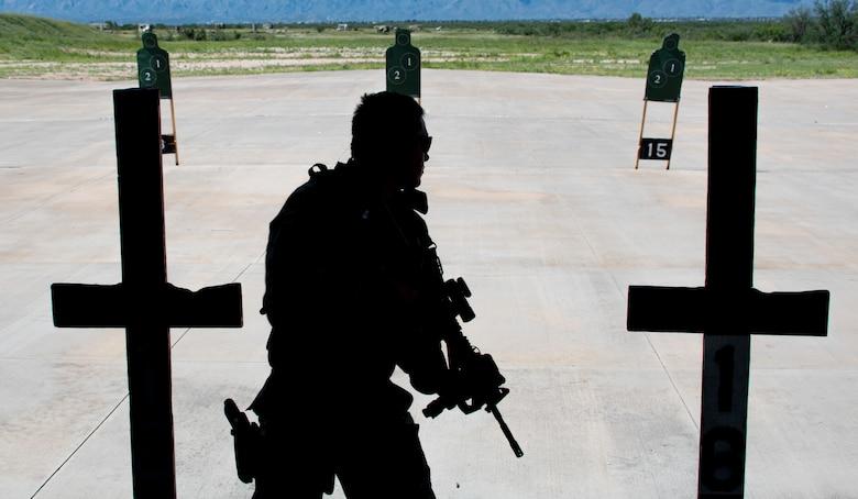 A photo of an airman holding a rifle