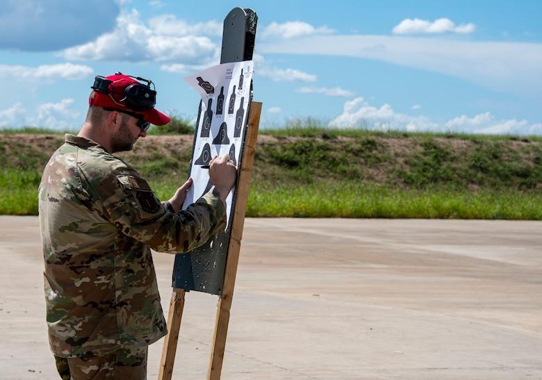 A photo of an airman on a firing range