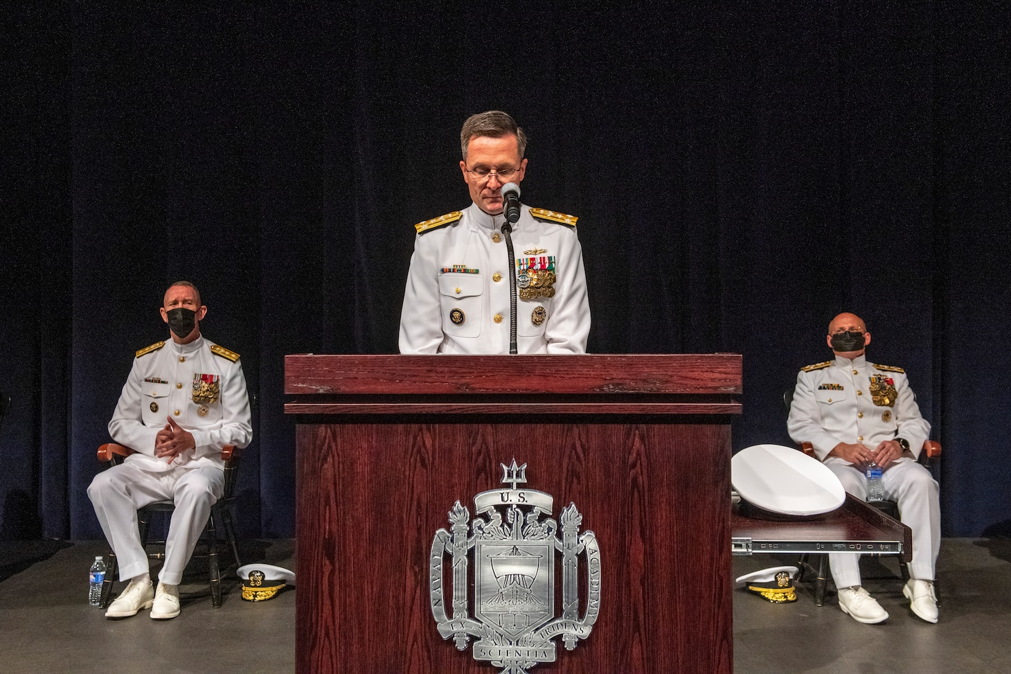 """Vice Adm. Darse """"Del"""" E. Crandall delivers remarks during a change of office ceremony at the U.S. Naval Academy in which he relieved Vice Adm. John G. Hannink and became the 45th Judge Advocate of the Navy."""