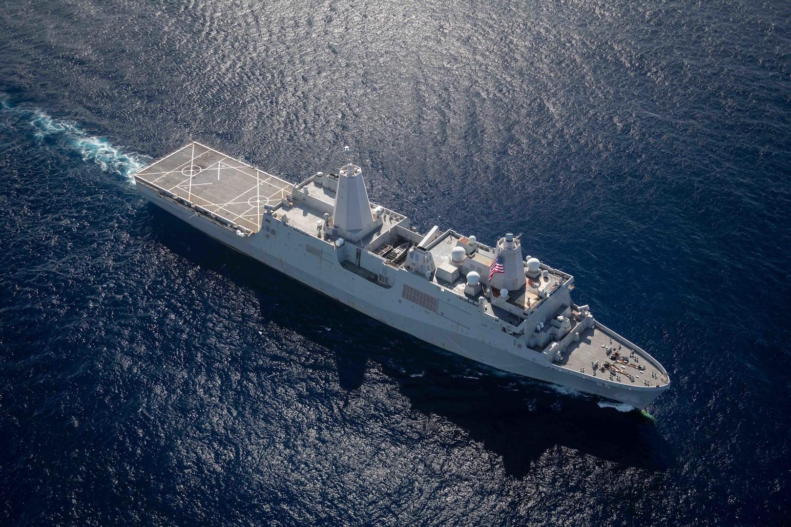 The San Antonio-class amphibious transport dock ship USS Arlington (LPD 24) transits the Atlantic Ocean Aug. 14, 2021.
