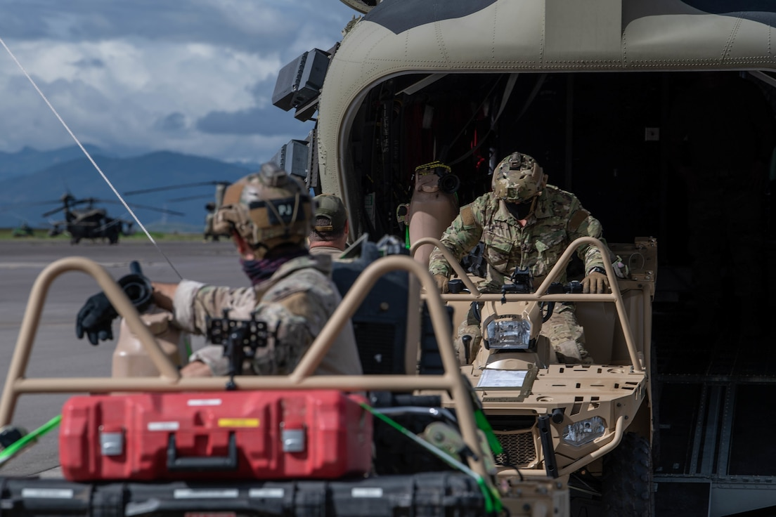 U.S. Air Force Special Tactics operators load tactical vehicles onto a U.S. Army CH-47 Chinook helicopter at Soto Cano Air Base, Honduras, Nov. 23, 2020, while prepping for a landing zone assessment and survey mission.