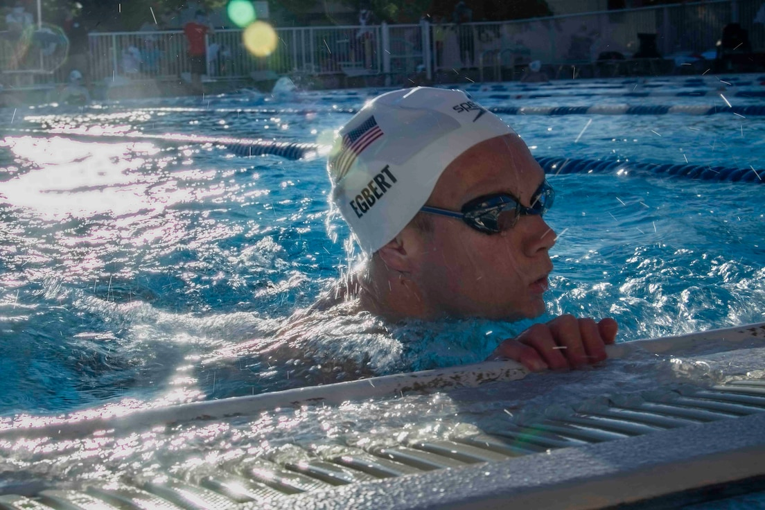 Parker Egbert, U.S. Paralympic swimmer, finishes a practice lap at Yokota Air Base, Japan, Aug. 18, 2021, before competing in the 2020 Summer Paralympic games in Tokyo.