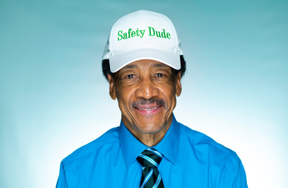 """Bernard """"Safety Dude"""" Bruce, U.S. Air Force retired 56th Fighter Wing Occupational Safety and Health manager, wears his 'Safety Dude' hat July 30, 2021, at Luke Air Force Base, Arizona. Bruce retired after a combined service of more than 50 years to the Air Force--26 years of active duty and 24 years as a government-service employee. During his time with the Air Force Bruce held many roles including being an Air Traffic Controller in the Vietnam War, a radio host for Air Force's Radio and Television Network, the 56th Fighter Wing Occupational Safety and Health manager and the historian for the local Tuskegee Airmen Incorporated chapter. (U.S. Air Force photo by Senior Airman Leala Marquez)"""