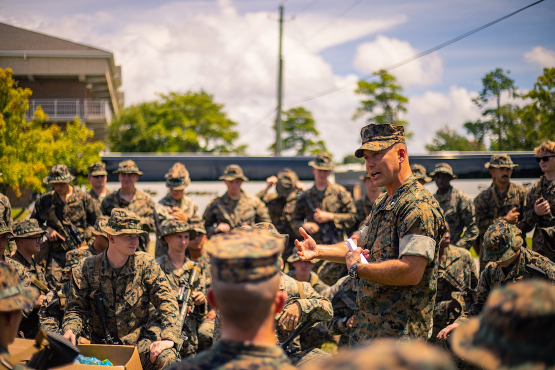 U.S. Marine Corps Lt. Col. Mastin Robeson, the battalion commander with 1st Battalion, 6th Marine Regiment, 2d Marine Division, gives a speech in preparation to depart Camp Lejeune, N.C., Aug. 18, 2021. The Marines from 1/6 are preparing to deploy in support of Joint Task Force-Haiti for a humanitarian assistance disaster relief mission. (U.S. Marine Corps photo by Staff Sgt. Akeel Austin)