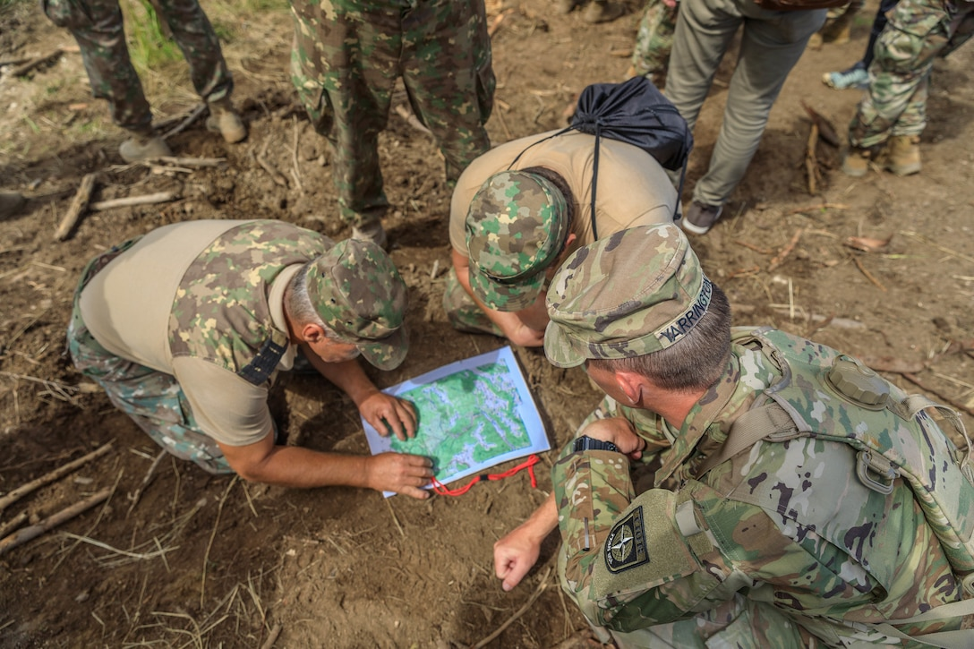 American and Romanian reserve service members participate in an orienteering training event