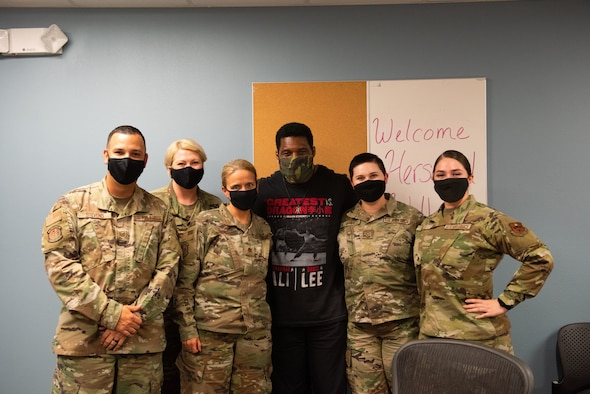 Herschel Walker poses with members of the 47th Medical Group on Aug. 18, 2021 at Laughlin Air Force Base, Texas. Walker talked with the staff about mental health, how it affects air force military members and what Laughlin AFB is doing to help their members work through these struggles by providing them with multiple resources to reach out to, such as the Mental Health Clinic and family life counselors at the Airman Family Readiness Center. (U.S. Air Force photo by Airman Kailee Reynolds)