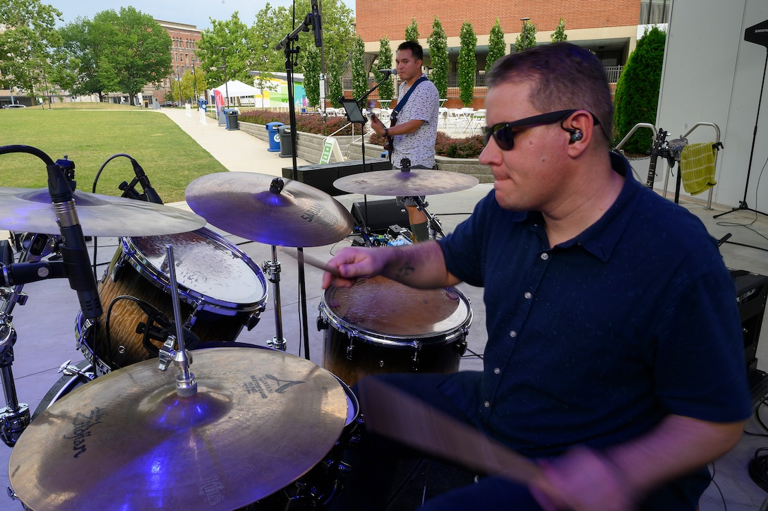 ech. Sgt. Andy Wendzikowski, drummer, and Airman 1st Class Christopher Arellano perform a sound check at Levitt Pavilion in Dayton, Ohio, on Aug. 7, 2021, prior to a scheduled performance of the Air Force Band of Flight's rock ensemble Flight One. (U.S. Air Force photo by R.J. Oriez)