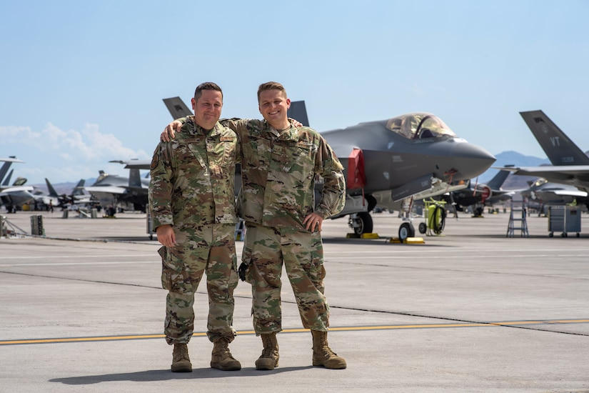 Two airmen pose for a photo.