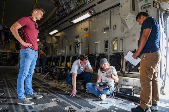 A team from the Air Force Institute of Technology, Air Force Research Lab, and Department of the Air Force/Massachusetts Institute of Technology Artificial Intelligence Accelerator prepare a Mag in a Box, a navigation system for GPS denied environments, for testing on a 445th Airlift Wing C-17 Globemaster III Aug 6, 2021. A team from the Air Force Institute of Technology, Air Force Research Lab, and Department of the Air Force/Massachusetts Institute of Technology Artificial Intelligence Accelerator are working on magnetic-navigation research and brought a stand-alone sensor to test on the C-17 help characterize the platform.