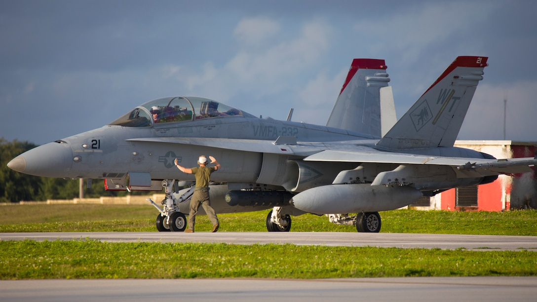 An F/A-18D Hornet aircraft with Marine Fighter Attack Squadron (VMFA) 232 taxis the flight line at Andersen Air Force Base, Guam, Aug. 13, 2021. VMFA-232 deployed to Andersen Air Force Base, Guam as part of the Aviation Training Relocation program, which is designed to increase operational readiness while reducing the impacts of training activities. (U.S. Marine Corps photo by Lance Cpl. Tyler Harmon)
