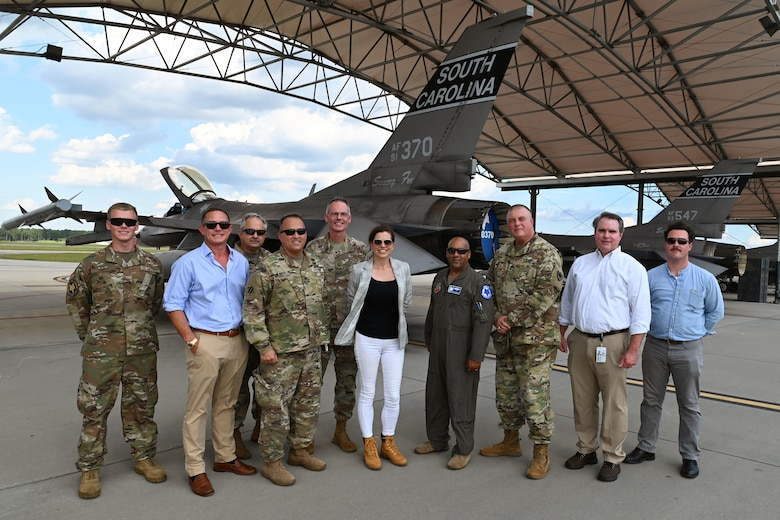 U.S. Rep. Nancy Mace from Charleston, South Carolina and her staff pose for a picture with leaders from the South Carolina National Guard in front of a 169th Fighter Wing F-16 Fighting Falcon jet during her visit to McEntire Joint National Guard Base, South Carolina Aug. 19, 2021. The purpose of her visit is to meet with South Carolina National Guard leadership to discuss the current state of the South Carolina National Guard and future endeavors for the organization as well as a familiarization of the base and the capabilities of the units housed there. (U.S. Air National Guard photo by Senior Master Sgt. Edward Snyder, 169th Fighter Wing Public Affairs)