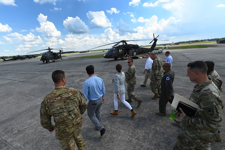 U.S. Rep. Nancy Mace and her staff from Charleston, South Carolina join leaders of the South Carolina National Guard on a tour of the helicopter flight line at McEntire Joint National Guard Base, South Carolina during her visit Aug. 19, 2021. The purpose of her visit is to meet with South Carolina National Guard leadership to discuss the current state of the South Carolina National Guard and future endeavors for the organization as well as a familiarization of the base and the capabilities of the units housed there. (U.S. Air National Guard photo by Senior Master Sgt. Edward Snyder, 169th Fighter Wing Public Affairs)