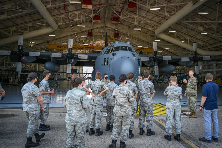 U.S. Air Force 2nd Lt. John Lane (right), assigned to the 103rd Maintenance Squadron, briefs Civil Air Patrol cadets on the 103rd Airlift Wing's C-130H Hercules tactical airlift mission during a tour of Bradley Air National Guard Base in East Granby, Connecticut, Aug. 13, 2021. Cadets from the Connecticut Wing's Danielson and Plainville squadrons got an up-close look at C-130H aircraft, the engines that power them, and learned about the 103rd Airlift Wing's mission. (U.S. Air National Guard photo by Tech. Sgt. Steven Tucker)