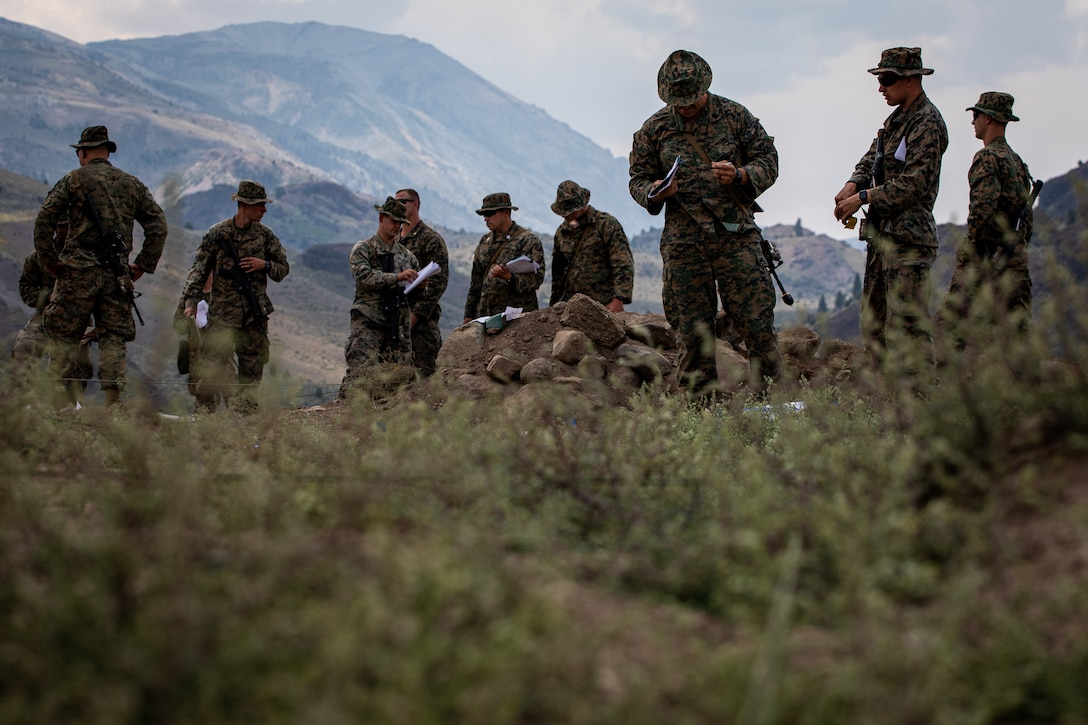 U.S Marines with the 2nd Battalion, 24th Marine Regiment and 4th Combat Engineer Battalion, 4th Marine Division, prepare for their final exercise at Marine Corps Mountain Warfare Training Center, California on July 26, 2021. MCMWTC offers a unique training experience for the Marines to prepare and develop an understanding of traversing a mountainous environment as they maintain their readiness to fight in any clime and place. (U.S. Marine Corps photo by Cpl. Ryan Schmid)