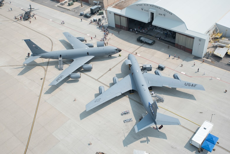 Two KC-135 Stratotankers sit in front of a hangar during Utah Air National Guard's bi-annual Wingman Day and 75th Anniversary event at the Roland R. Wright Air National Guard Base in Salt Lake City, Utah, Aug. 7, 2021. During the event the Utah ANG, in collaboration with Collins Aerospace, successfully demonstrated advanced communication, mission computing and sensor technologies to support Joint All Domain Command and Control and Advanced Battle Management initiatives on a KC-135.