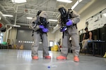 Weapons of Mass Destruction Civil Support Team members in protective equipment respond to a potential chemical, biological, or radiological threat while participating in a training event at Ft. Buchanan, Puerto Rico, Aug. 17, 2021. The training scenarios include response, evaluation, testing, and securing the area of contamination. The members are made up of soldiers and airmen from the 33rd WMD-CST, District of Columbia National Guard, along with other CST's from Texas, North Carolina, West Virginia, Puerto Rico and the District of Columbia Fire and Emergency Management Service. (U.S. Air National Guard photo by Senior Airman Amanda Bodony)