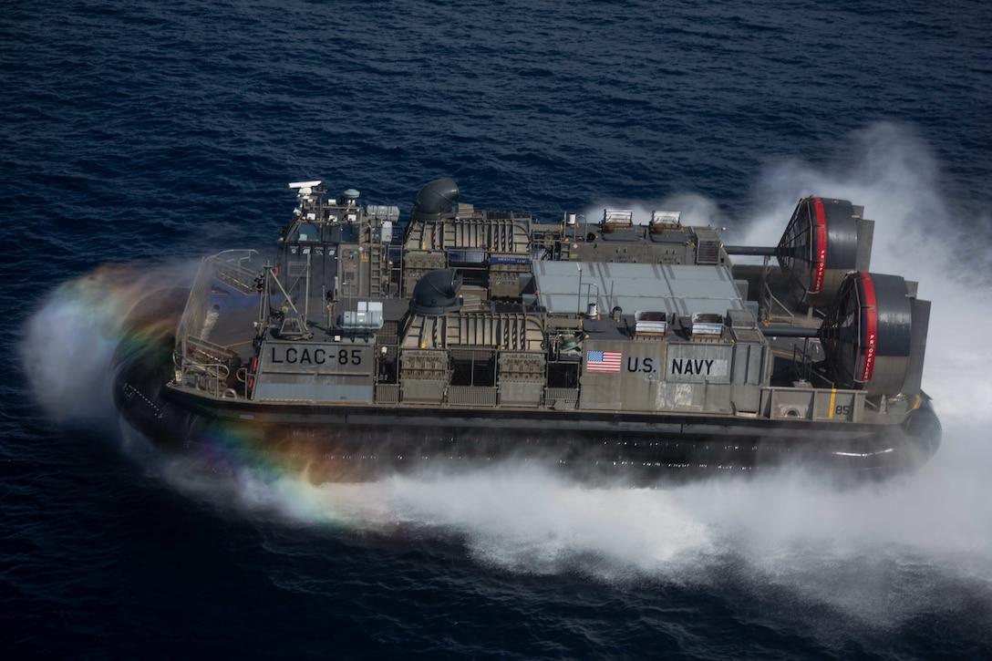 An air-cushioned landing craft moves through the water.
