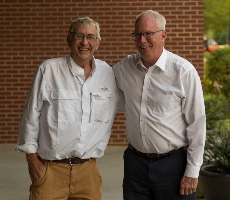 U.S. Army Engineer Research and Development Center's (ERDC) scientists and inventors John Furey and Cliff Morgan stand outside the ERDC Environmental Laboratory (EL) in Vicksburg, Mississippi, in 2013. The two were part of an ERDC EL Environmental Systems Branch team that developed an electronic collimator invention that detects gamma radiation, a penetrating form of electromagnetic radiation arising from the radioactive decay of atomic nuclei. The invention enables the warfighter with a detector capable of directional detection without the use of shielding. (U.S. Army Corps of Engineers photo)