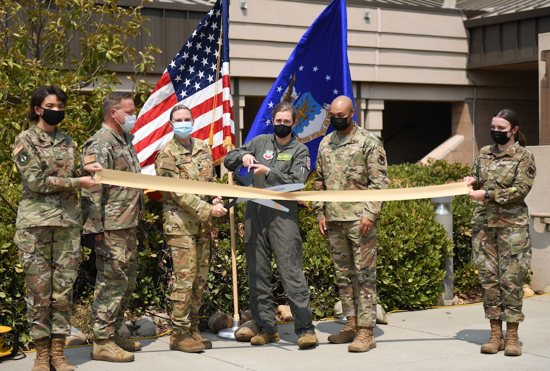 Col. Heather Fox, 9th Reconnaissance Wing commander and Lt. Col. Alisha Earls, 9th Physiological Support Squadron (PSPTS) commander, stands with other 9 PSPTS Airmen as they cut the ceremonial ribbon Aug. 20, 2021, at Beale Air Force Base, California.