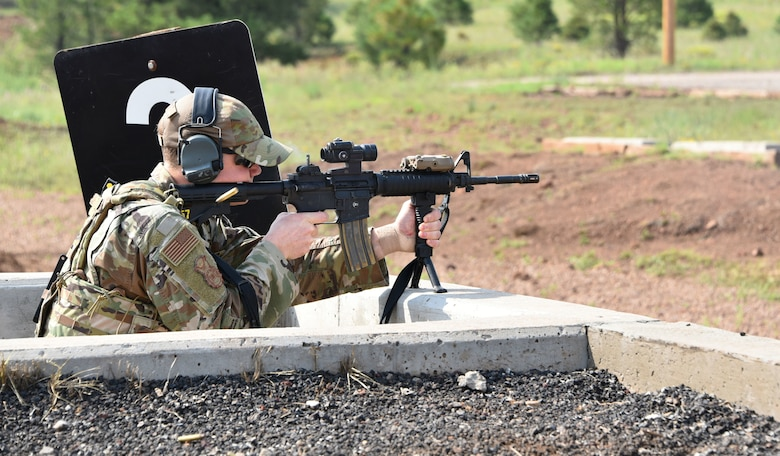 U.S. Air Force Senior Airman Auston Baker, a defender with the 161st Security Forces Squadron, steadies his aim as he shoots at his targets on the firing range at Camp Navajo, Arizona, Aug. 17, 2021.