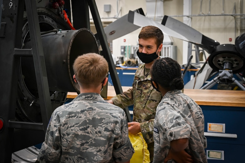 Senior Airman Thomas Sousa, 103rd Maintenance Squadron aerospace propulsion specialist, shows a C-130H Hercules engine to Civil Air Patrol cadets during a tour of Bradley Air National Guard Base in East Granby, Connecticut, Aug. 13, 2021. Cadets from the Connecticut Wing's Danielson and Plainville squadrons got an up-close look at C-130H aircraft, the engines that power them, and learned about the 103rd Airlift Wing's mission. (U.S. Air National Guard photo by Tech. Sgt. Steven Tucker)