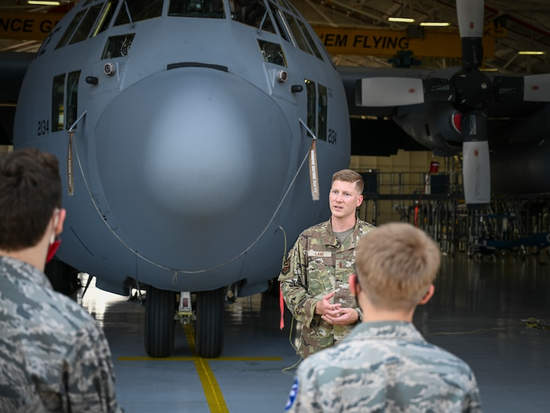 U.S. Air Force 2nd Lt. John Lane, assigned to the 103rd Maintenance Squadron, briefs Civil Air Patrol cadets on the 103rd Airlift Wing's C-130H Hercules tactical airlift mission during a tour of Bradley Air National Guard Base in East Granby, Connecticut, Aug. 13, 2021. Cadets from the Connecticut Wing's Danielson and Plainville squadrons got an up-close look at C-130H aircraft, the engines that power them, and learned about the 103rd Airlift Wing's mission. (U.S. Air National Guard photo by Tech. Sgt. Steven Tucker)