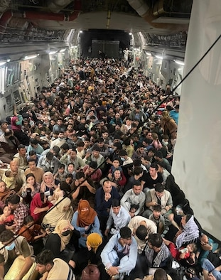 A U.S. Air Force C-17 Globemaster III safely transported 823 Afghan citizens from Hamid Karzai International Airport, Aug. 15, 2021. The initial count of 640 passengers included only adults, inadvertently leaving off 183 children seated in laps as passengers were transported from the flight line. The correct total passenger count of 823 is a record for the C-17. (U.S. Air Force courtesy photo)