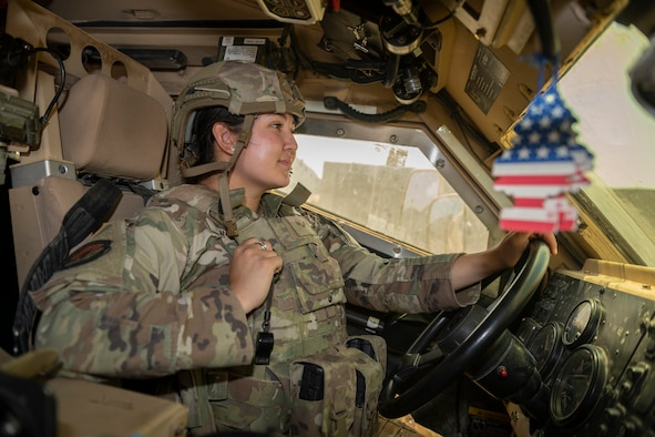 U.S. Air Force Senior Airman Lillianna Sanchez, 332nd Expeditionary Security Forces Squadron response force member, performs a perimeter check July 31, 2021, in an undisclosed location somewhere in Southwest Asia. The 332nd ESFS is tasked with providing force protection, ensuring operational readiness and protecting warfighting resources as well as its personnel. (U.S. Air Force photo by Senior Airman Cameron Otte)