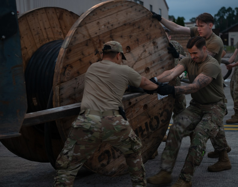 Airmen prepare tents and supplies.