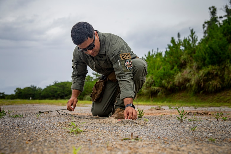 U.S. Marine Corps Sgt. Jose Gonzalez, an explosive ordnance disposal (EOD) technician with Marine Corps Base Camp Butler EOD, prepares a shock-tube during a demolition range on Camp Hansen, Okinawa, Japan, Aug. 18, 2021. EOD technicians conducted a demolition range to increase proficiency in using nonstandard demolition techniques including drop-charge detonations, time-fuse setups and a robotics platform to remotely emplace charges. Gonzalez is a native of Port Chester, New York. (U.S. Marine Corps photo by Lance Cpl. Alex Fairchild)