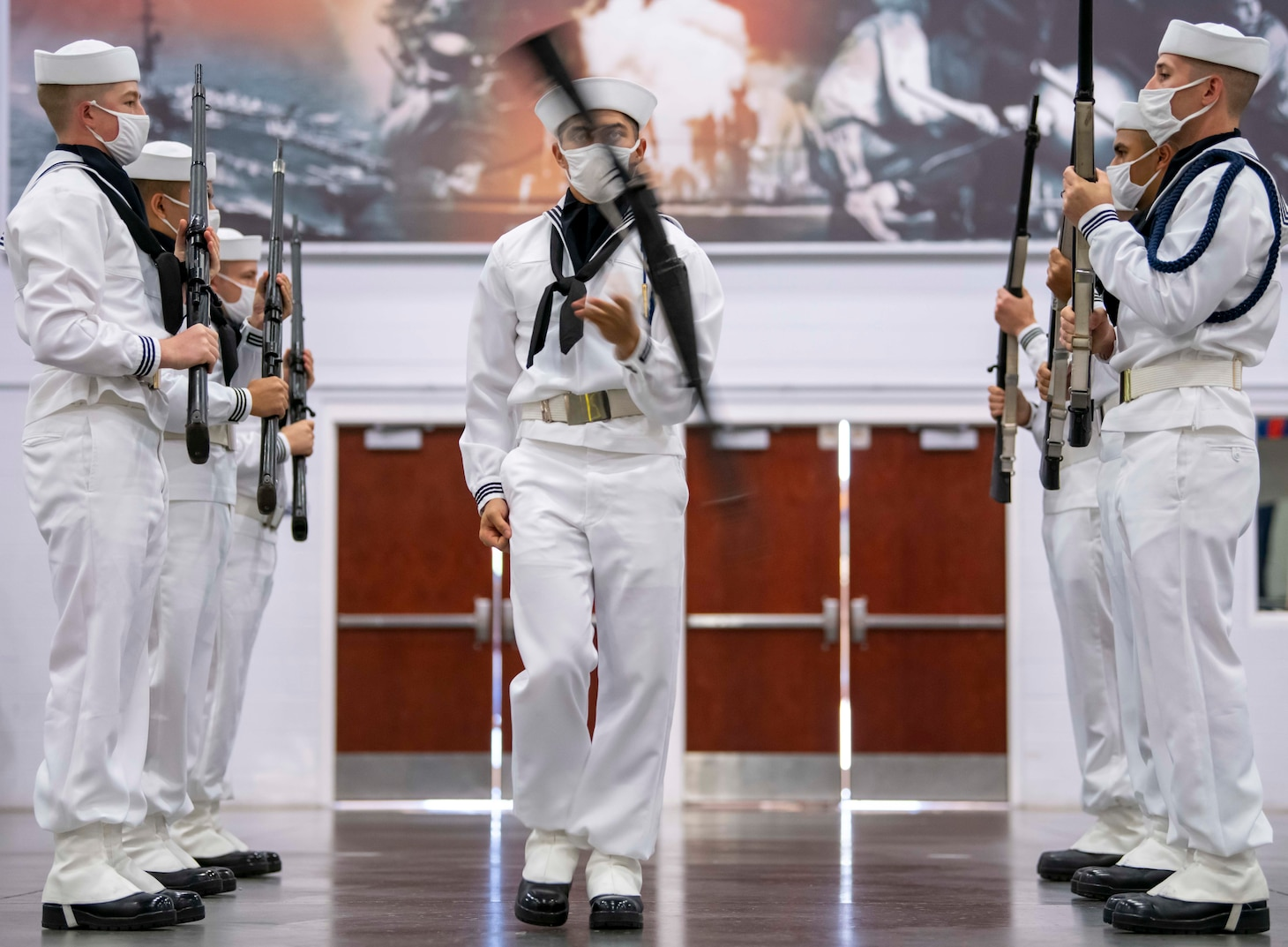 Members of the recruit drill team perform during a pass-in-review graduation ceremony at Recruit Training Command.