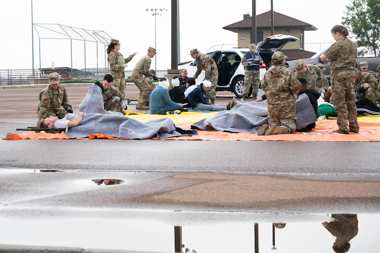 Members of the 341st Medical Group assess and provide initial treatment for patients simulated by volunteers during a medical readiness exercise Aug. 20, 2021 at Malmstrom Air Force Base, Mont.