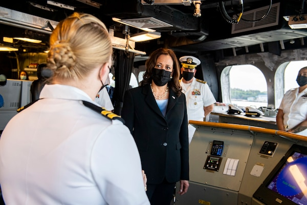 Vice President Kamala Harris discusses navigation with Lt. Katie Canant during a visit aboard the Independence-variant littoral combat ship USS Tulsa (LCS 16), Aug. 23, 2021.