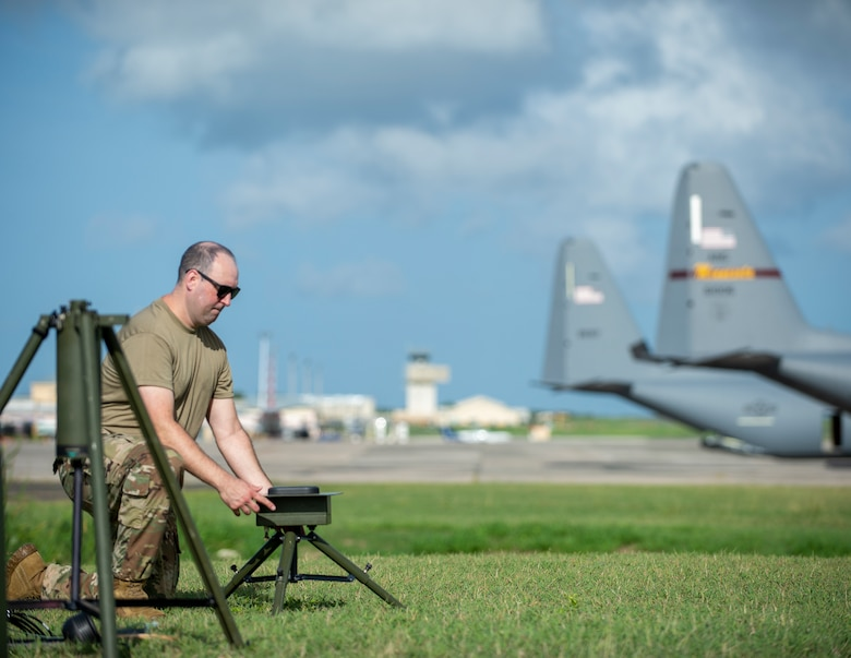 U.S. Air Force Master Sgt. Johnie Smith, 136th Contingency Response Flight, Texas Air National Guard, sets up the TMQ-53 portable weather station in St. Croix, Virgin Islands, Aug. 17, 2021.