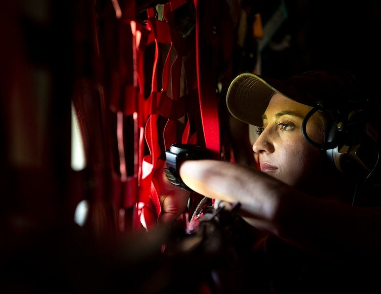U.S. Air Force Tech. Sgt. Baylee Munce, 133rd Contingency Response Flight, Minnesota Air National Guard, looks out a window on a C-130 Hercules from the 133rd Airlift Wing, over the skies of Puerto Rico, Aug. 18, 2021.