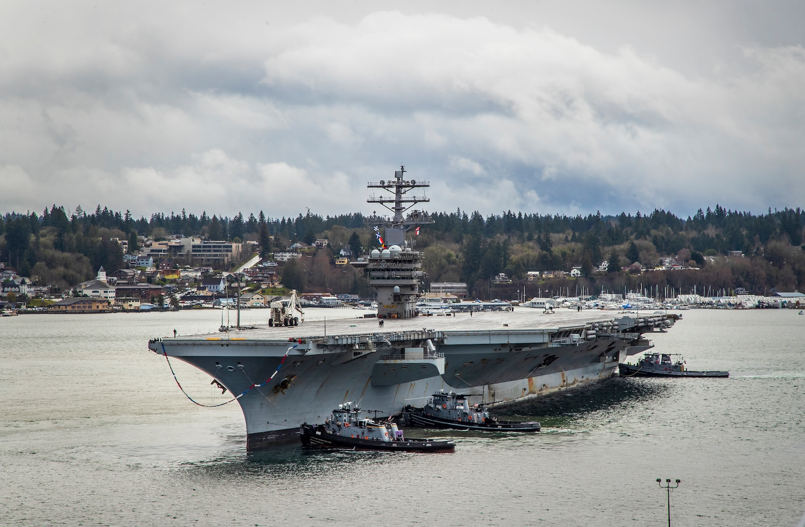 USS Nimitz (CVN 68) arrives at Naval Base Kitsap-Bremerton March 7, 2021. The ship's arrival completed a nearly 11-month deployment to U.S. 3rd, 5th and 7th Fleets, including participation in Operations Freedom's Sentinel, Inherent Resolve and Octave Quartz. The Nimitz Project Team reached the halfway point of its Planned Incremental Availability Aug. 11, 2021. (PSNS & IMF Photo by Wendy Hallmark)