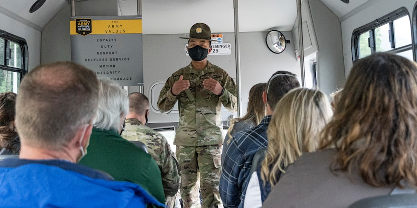 Drill Sergeant and Alaska Army National Guard Soldier Staff Sgt. Kevin Apolinar, assigned to the AKARNG Recruiting Battalion, elaborates on the core Army values to a group of local business representatives from the Anchorage area, Aug. 20, 2021 on Joint Base Elmendorf-Richardson as part of a Maintenance Showcase highlighting the AKARNG's Partnership for Youth Success program. (U.S. Army National Guard photo by Sgt. Seth LaCount)