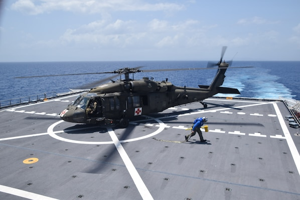 A U.S. Army UH-60 Blackhawk helicopter prepares to take off from the flight deck of the Spearhead-class expeditionary fast transport ship USNS Burlington (T-EPF 10) after refueling, Aug. 21, 2021.