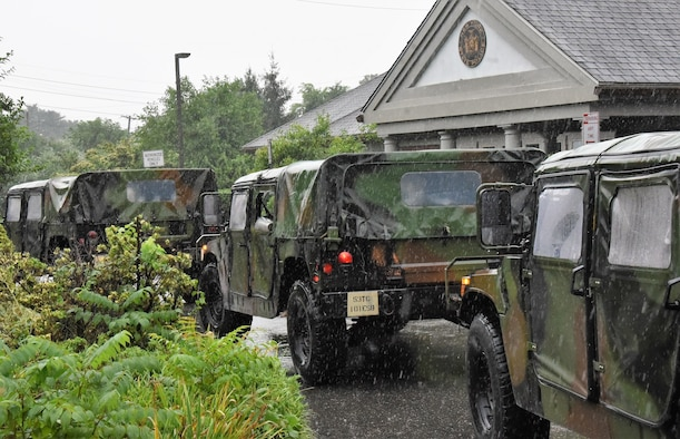 Humvees in front of the New York State Police Troop L in Brentwood, New York, Aug. 22, 2021, as part of the New York National Guard response to the anticipated landfall of Tropical Storm Henri. The Guard activated 500 Soldiers and Airmen on Long Island, New York City and in the Hudson Valley and Albany area to respond to any government requests for assistance.
